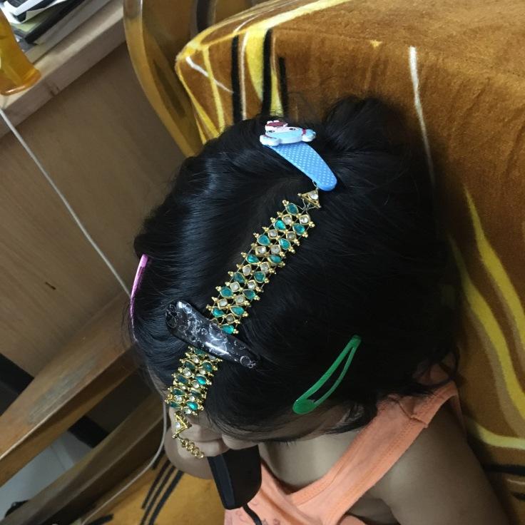 kid in 'maangtika- a head ornament